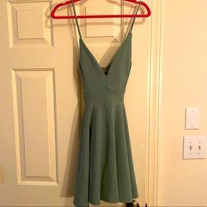 Deep-V spaghetti strap sage green mini dress